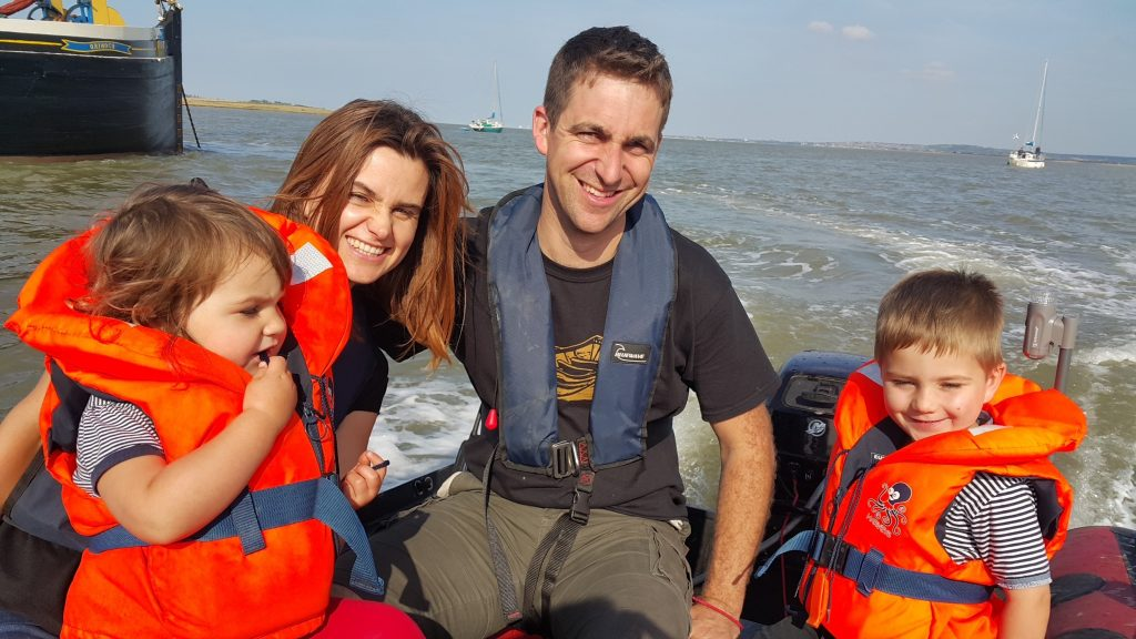 Jo, Brendan, Cuillin and Lejla Cox in their dinghy, 2015 Courtesy of Jo Cox's family Jo and her family are pictured here at The Swale, a tidal stream near the mouth of the River Thames. The Swale was a regular destination with their boat. They would anchor in the channel, swim to the shore and play on the mudflats.